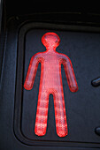 'A red illuminated human figure;Cannes france'