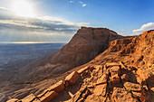'Rugged terrain and sunbeams at sunrise;Masada israel'