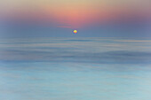 'Sun rising over blurred water;Spain'