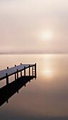 A Foggy Sunrise Over A Dock In Lake Whatcom During Winter, Bellingham Washington, Usa