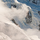 'Aerial view of snow covered mountains with cloud;Chamonix-mont-blanc rhone-alpes france'
