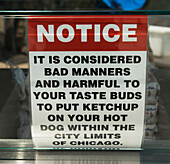 'Humorous sign about the use of ketchup on hot dogs;Chicago illinois united states of america'