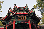 'A building with traditional chinese architecture against a blue sky;Beijing china'