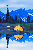 'Camping tent at sunset small reflecting pond near tipsoo lake mount rainer national park near seattle;Washington united states of america'