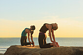 'Women Practising Yoga Near Pacific Beach; San Diego California United States Of America'