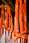 'Sockeye salmon from the kvichak river that has been stripped and hung to dry and smoke hang in a large smokehouse;Igiugig bristol bay alaska united states of america'