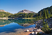'Mountain reflecting in a lake in the early morning lassen volcanic national park;California united states of america'
