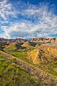 'Afternoon sunshine hits the yellow mounds region in badlands national park; south dakota united states of america'