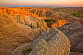 'The setting sun lights up the formations in badlands national park as seen from the pinnacles lookout; south dakota united states of america'
