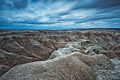 'Long exposure of clouds overtop of badlands national park; south dakota united states of america'