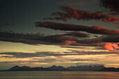 'Dramatic sky at sunset over the ocean;Skye scotland'