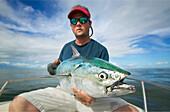 'Man holding a false albacore tuna off the coast of north carolina; north carolina united states of america'