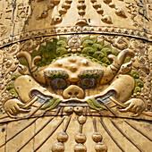 'Face carved into a wall at jokhang temple;Lhasa xizang china'