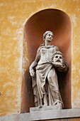 'Theatrical statue on a building framed in an arch;Ravenna emilia-romagna italy'