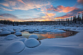 'Red clouds at sunset over mcintyre creek;Whitehorse, yukon, canada'