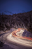 'Vehicle taillight trails on a snowy road in winter;Alaska, united states of america'