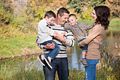 'A family spending time together in a park in autumn;St. albert alberta canada'