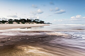 'Tallows creek running out into the ocean at a spot known as dolphins at tallows beach after heavy storms;Byron bay new south wales australia'