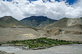 'Terraces mountains and clouds near tirigaon village kali gandaki river;Upper mustang nepal'