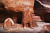'Rock carved into the lower half of a human body;Petra jordan'