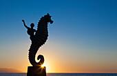 'The seahorse sculpture on the malecon at sunset;Puerto vallarta mexico'