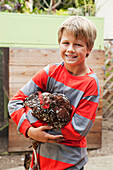 'A boy holds a chicken;San francisco california united states of america'
