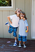 'Brothers posing with pretend moustaches;Pacifica california united states of america'