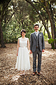 'Portrait of a couple standing in a park in formal wear;California united states of america'