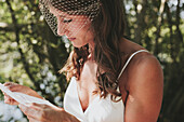 'A bride reading from a piece of paper;Kirkland washington united states of america'