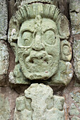 'A Stone Face Carved Into A Stone Wall In A Maya Civilization At Copan Ruins; Copan, Honduras'