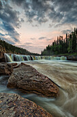 'The Trout River flows over Sambaa Deh Falls in Sambaa Deh Territorial Park; Northwest Territories, Canada'