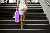 'Mature Professional Businesswoman Shopping In Downtown Urban Business Environment; Edmonton, Alberta, Canada'