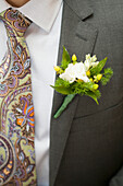'Groom's boutineer and tie detail; Starkville, Mississippi, United States of America'