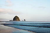 'Haystack Rock at Cannon Beach, a famous landmark; Cannon Beach, Oregon, United States of America'