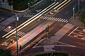 'High angle view of an intersection with painted arrows and crosswalks; Honolulu, Oahu, Hawaii, United States of America'