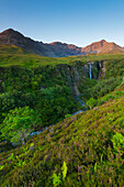 'Looking up river to the Eas Mor waterfall and the hills of the Black Cuillin at dusk; Isle of Skye, Scotland'