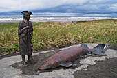 'Statue of a man and fish found along the Trail of Discovery; Long Beach, Washington, United States of America'