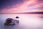 'Long exposure makes the water of Lake Michigan into mist on a cloudy morning; Wisconsin, United States of America'