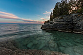 'Clouds stretched out by a long exposure in Cave Point, Sturgeon Bay; Wisconsin, United States of America'