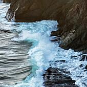 'Waves crashing against the rugged atlantic coast; Port Rexton, Newfoundland and Labrador, Canada'