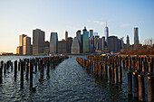 'View of financial district of Manhattan from Brooklyn Bridge Park at sunset; New York City, New York, United States of America'