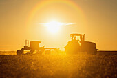 'Farmer planting cover crop over soybean stubble in Kent County; Rock Hall, Maryland, United States of America'