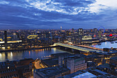 'View over the River Thames, Tate Modern and London Eye Wheel at dusk; London, England'