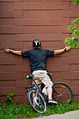 'Cyclist crashing into a wall on a bike path; Edmonton, Alberta, Canada'