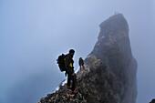 Early moning start: mountaineers on the Mitteleggi-Ridge, Eiger (3970 m), Bernese Alps, Switzerland
