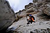 Kid is crossing a dangerous passage below Weisswand, Pflerschtal, South Tirol, Italy