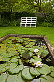Bench at the lily pond, Monk's house, home of the writer Virginia Woolf, Rodmell, East Sussex, Great Britain