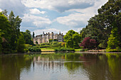 View across Ten Foot Pond to Sheffield Park House, Sheffield Park Garden, East Sussex, Great Britain
