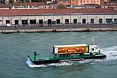 Truck on transport barge passing Canale della Giudecca, Venice, Veneto, Italy