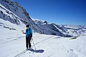 Female back-country skier controlling GPS-device, Griererkar, Realspitze, Zwerchwand, Zillertal, Zillertal Alps, Tyrol, Austria